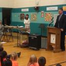 Attorney General J.B. Van Hollen addressing Jefferson Elementary students in Green Bay before announcing winner of the 2012 AMBER Alert Poster Contest.